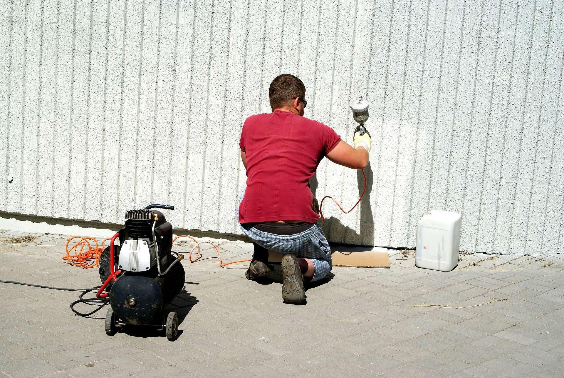 A man Spraying Polyurethane