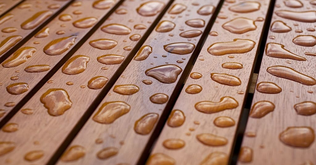 Can you stain a deck while it's raining